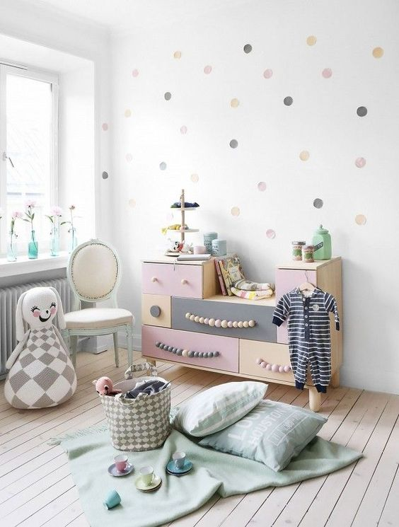 pastel sideboard with wooden bed handles for a little girl