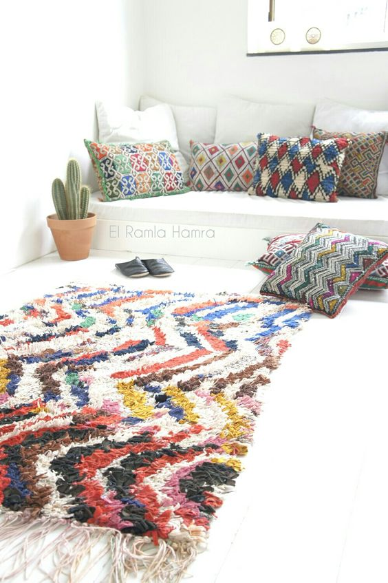 vintage Moroccan boucherouite rug and kilim cushions