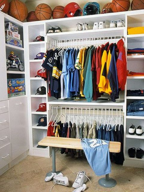 boy's closet with open shelving for balls above