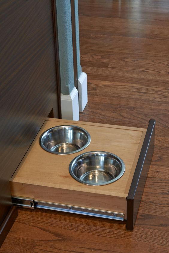 a pair of bowls can be pulled out from beneath the kitchen island