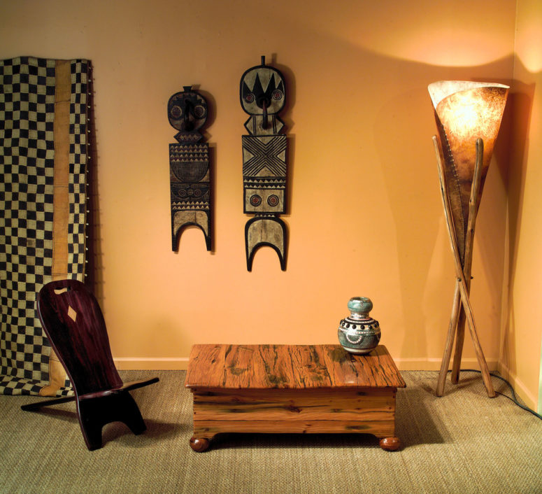 "Furniture made of jarrah wood could definitely become an African-inspired touch to any room's decor. African ""plank masks"" are also perfect for a themed room. (Phases Africa)"