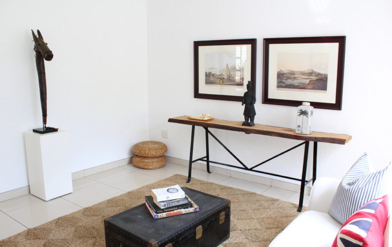 Using a chest as a coffee table work as a charm for a ethnic-themed room. (Illuminate Home Staging)