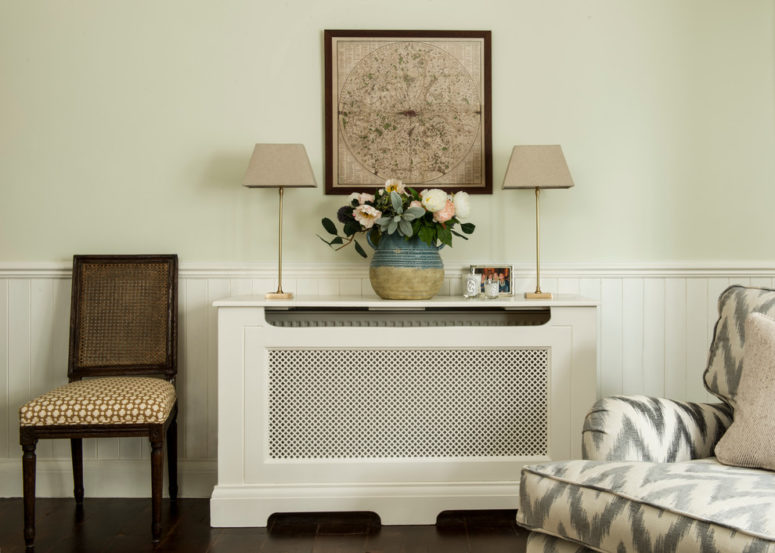 a practical solution to cover an ugly radiator that is designed like a console table (Lisette Voute Designs)