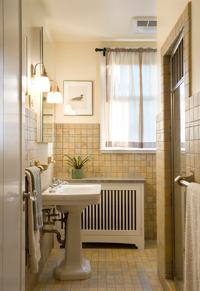 a radiator cover is a must for a bathroom because you can't hide radiators there any other way (Hughes Studio Architects)