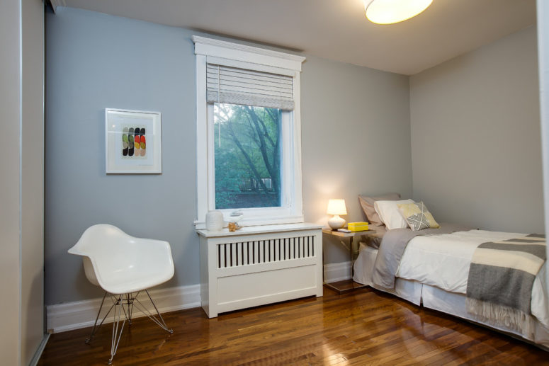 a simple radiator cover in a bedroom that makes a window sill's surface larger (The Graces - ReMax Hallmark Realty)