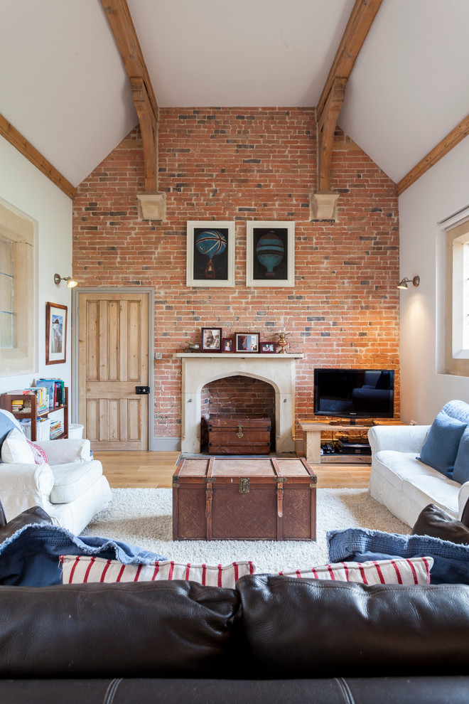 Even if a fireplace isn't functional and simply serves as an element of decor, a brick wall is a cool idea to surround it. (Chris Snook)