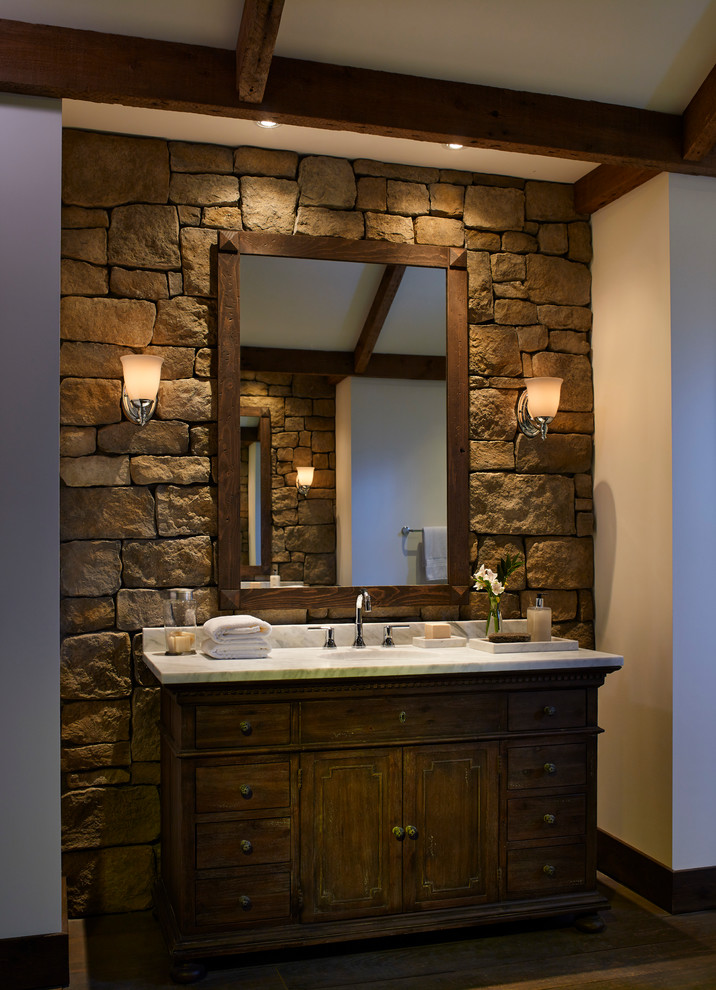 Faux stones that mimic traditional limestone with all its artefacts and rough shapes are perfect to install around the vanity. (Eldorado Stone)