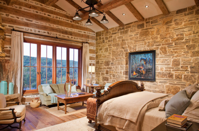 Natural stone wall looks great combined with exposed beams and pine flooring. (WoodCo)