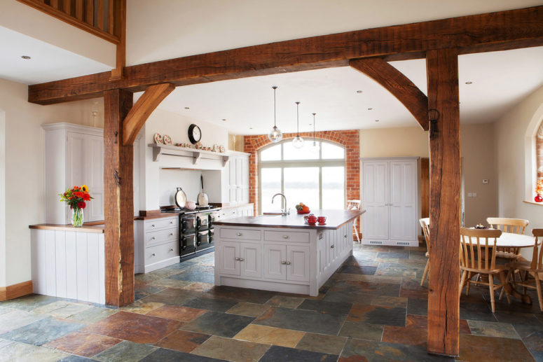 Barn-inspired interiors looks great with natural stone-inspired tiles. (Hill Farm Furniture Ltd)