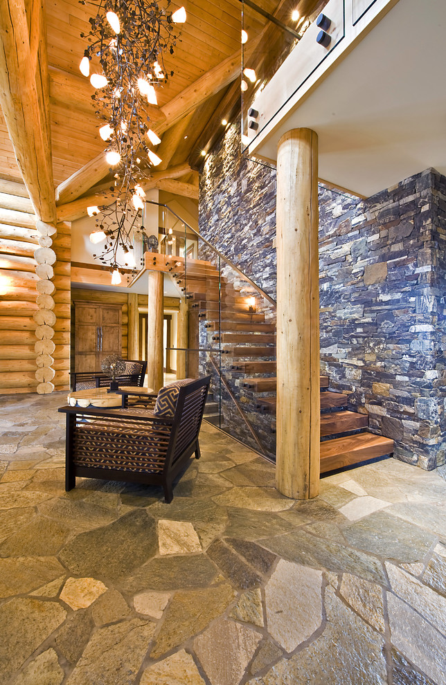 This cozy space features only natural materials and is a great example of a remote cabin interior.  (Sticks + Stones Design Group inc.)