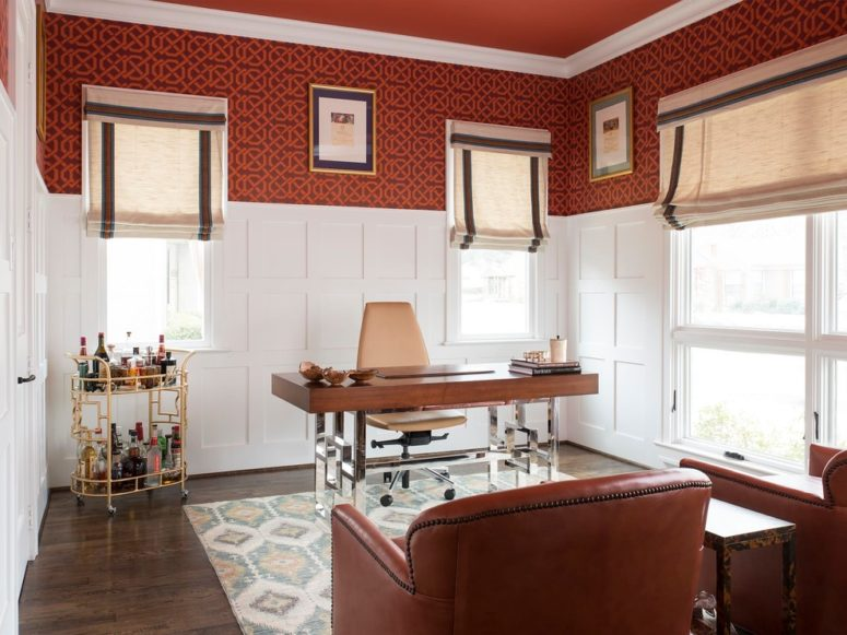 Plain white wainscoting works extremely well combined with a bold wallpaper. (Creekview Custom Homes)