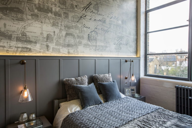 Dark grey wainscoting acts as a headboard in this contemporary bedroom. (Milward Teverini)