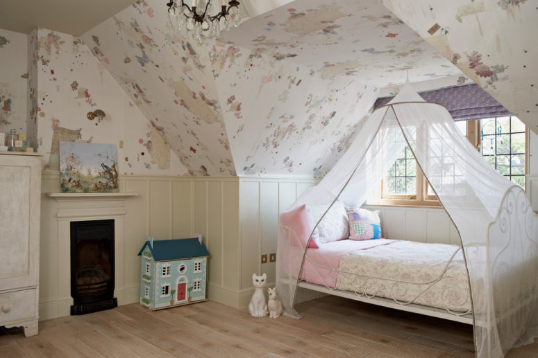 Beige wainscoting in this kids room could act as an easy to clean wallpaper protection. (Godrich Interiors)