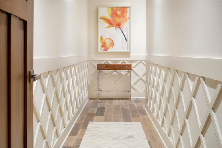 Lattice wainscoting makes this plain entryway much more interesting. (JAUREGUI Architecture Interiors Construction)