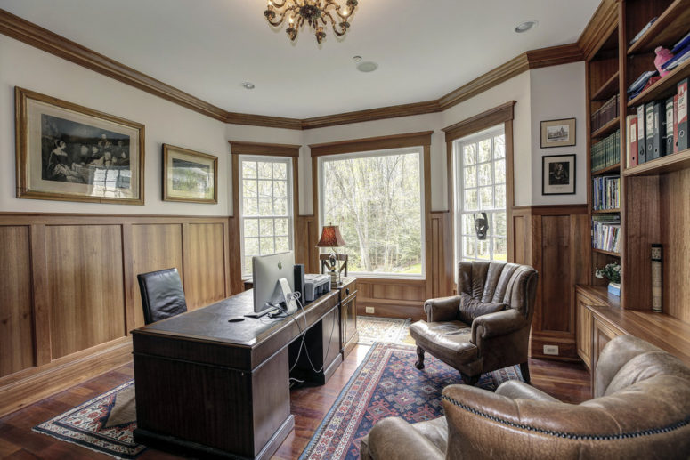 Wood wainscoting looks great combined with wood trimmings and furniture in this gorgeous home office.