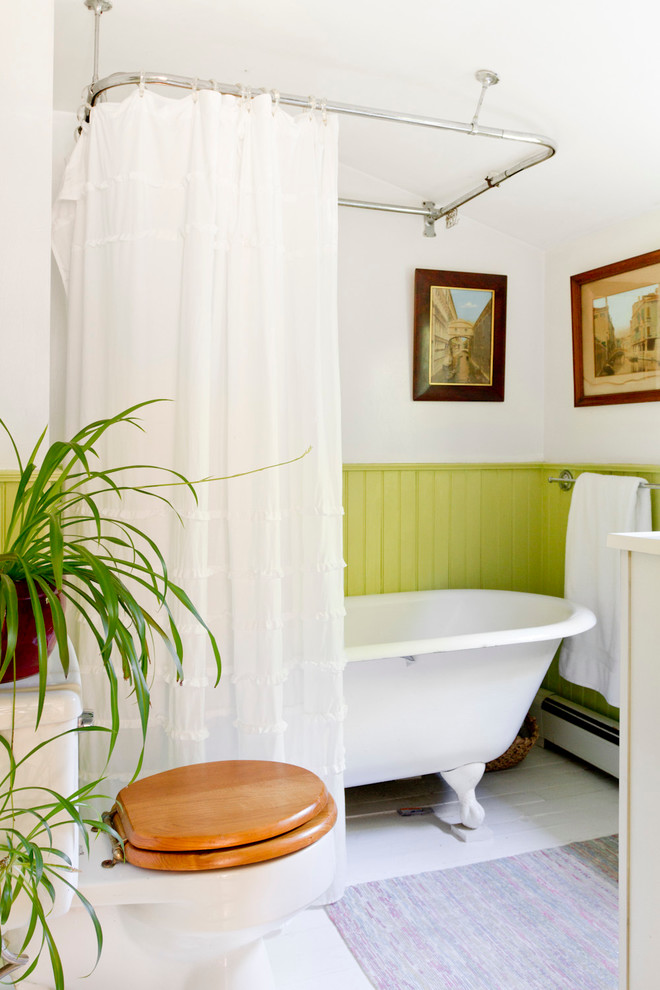 Green wainscoting creates contrast in this neutral-looking bathroom. (Rikki Snyder)