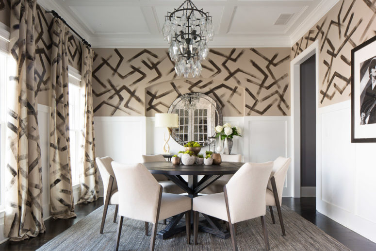 Simple white raised wood paneling to create contrast with a patterned wallpaper. (FORBES +