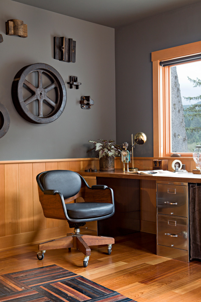 Wood paneling in natural warm stain looks great on dark gray walls. (Jessica Helgerson Interior Design)