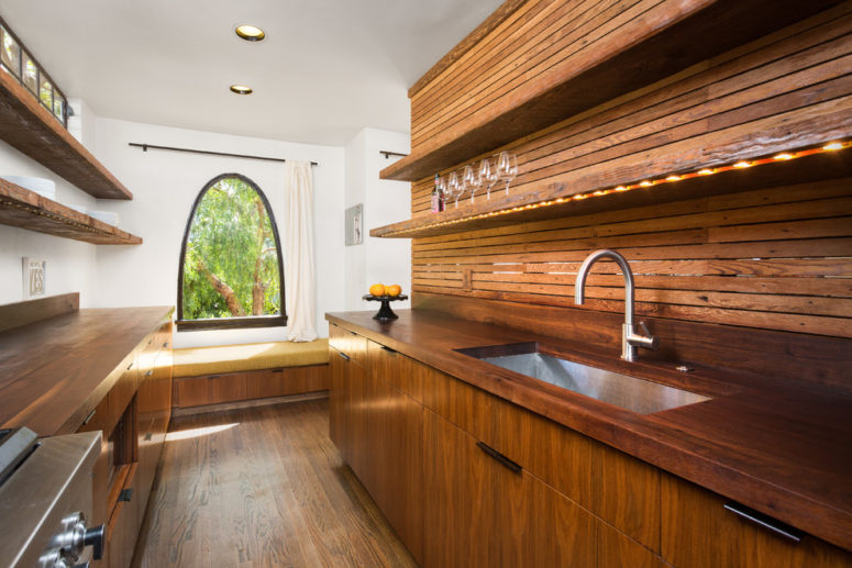 Installing a wood backsplash might be the easiest way to create a wood accent wall on a kitchen. (Hsu McCullough)