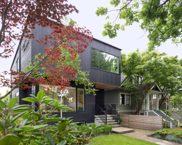 Modern house clad in thin strips of black cedar with a sculptural feel