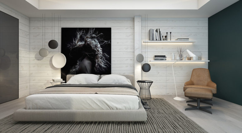 The master bedroom is clad with whitewashed wood and there's a cool oversized black and white artwork