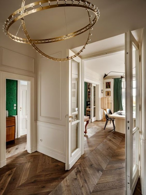 This apartment is located in Warsaw but is decorated in 1930s Paris style with a touch of irony