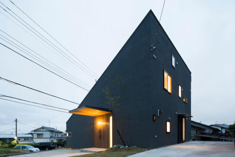 This minimalist home has a unique angular look and is painted grey on the outside