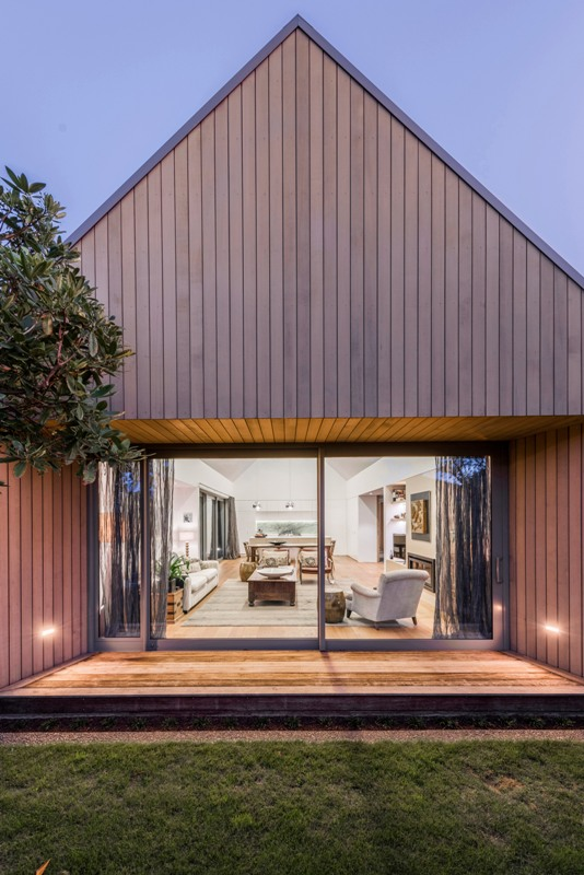 This modern cedar clad home reminds of an English country house with a gabled roof
