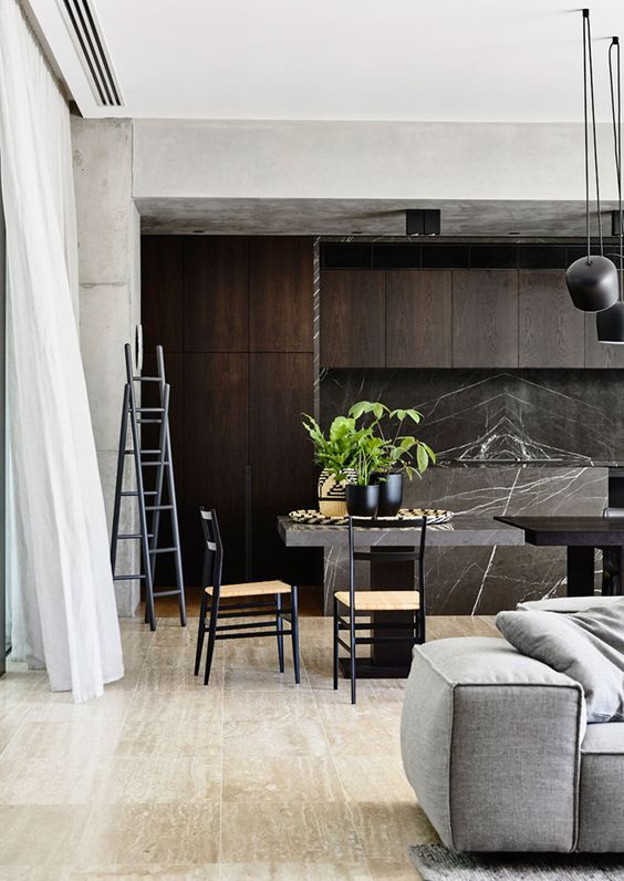 The decor is rather dark, masculine, with dark wood, black frames and touches