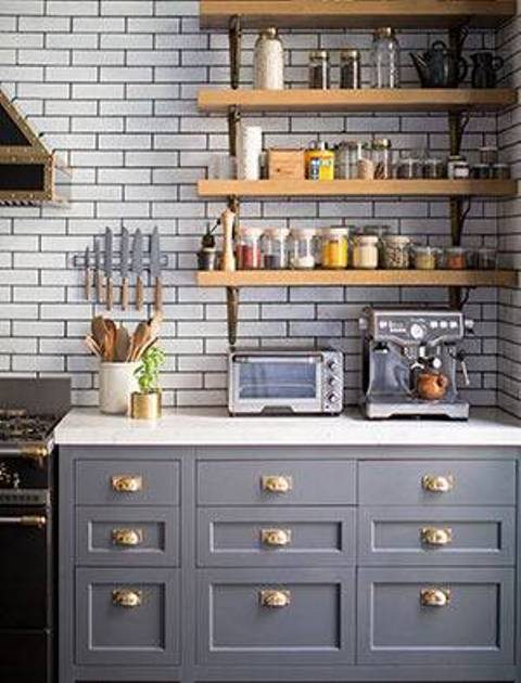 The kitchen is the focal point for certain reasons, it has grey mid century cabinets with gold handles