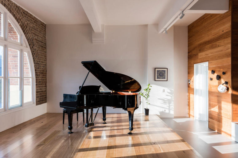 There's no better place for a large piano than a cool brick corner filled with light