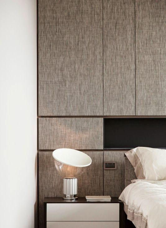 rough fabric texture on the headboard wall spruces up a laconic bedroom