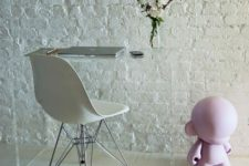 02 rough white brick stands out as a textural feature, and an acrylic desk doesn't distract attention from the wall
