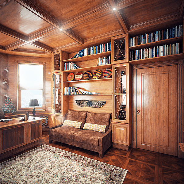 A small sofa is placed next to the desk in the built-in shelves