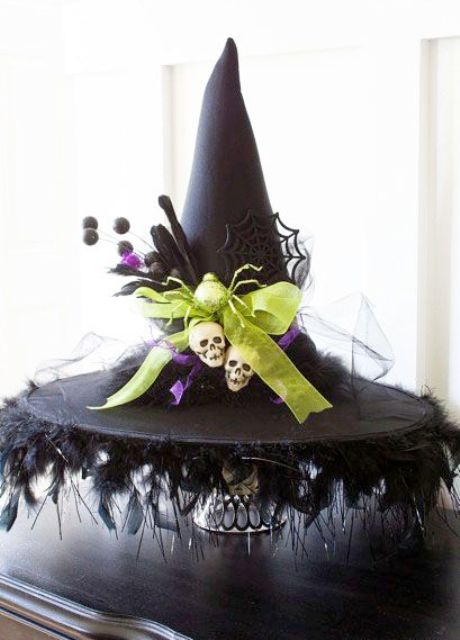 diy witch hat decoration with skulls and spider web