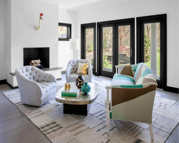 Gold and turquoise touches refresh the decor, and a simple rug adds coziness