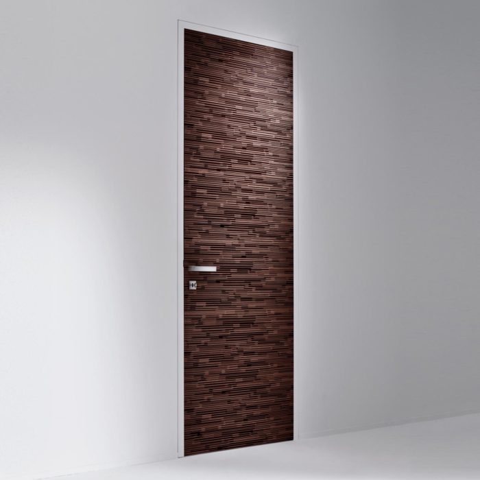 Such doors strike with minimal design and the jamb merges with the wall