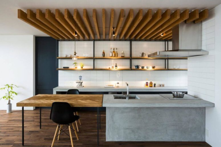 The ceiling is decorated with wooden planks, and the tabletop is clad in chevron pattern