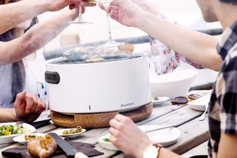 The device features a small grill top with a enclosed lid that can be removed and slotted underneath the barbecue when in use