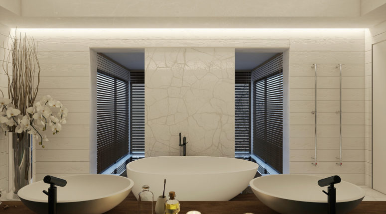 The master bathroom is clad with white marble and wood, there's a free-standing bathtub