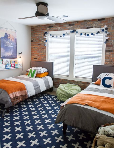 exposed brick wall is a perfect fit for a boys' bedroom