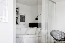 03 glass partition with a sheer curtain to complement minimalist decor and get some privacy