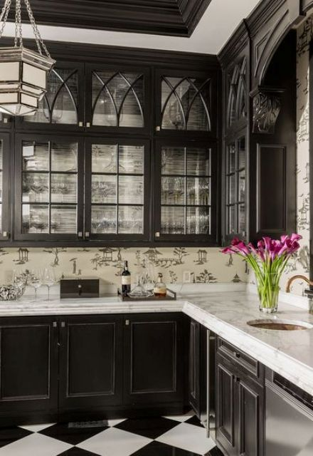 traditional black and white kitchen with glass cabinets and chinoiserie wallpaper