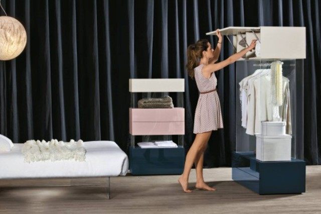 Air Wardrobe combines glass supports with drawers and clothes seem to be hung onto a cloud