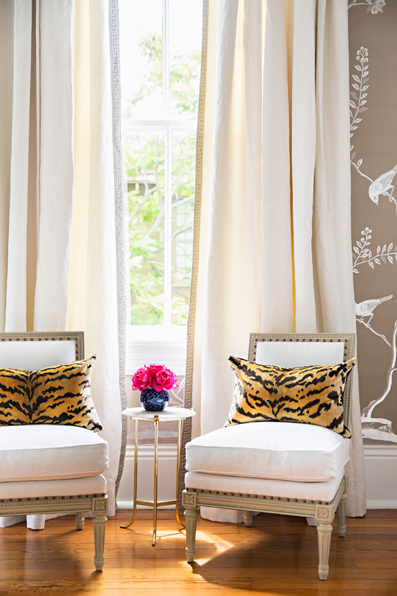 Antique chairs contrast with animal print cushions