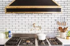 04 The hood and cooker are art deco, in black and gold. Masterpieces are created here