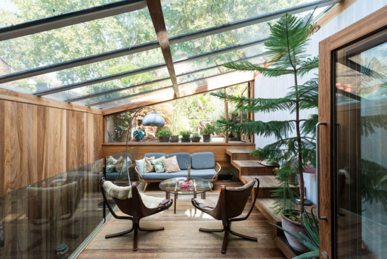 This is a glazed terrace with greenery added as an extension, it's a secluded place for a rest