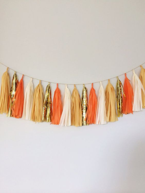 tassel garland in cream, orange and gold colors