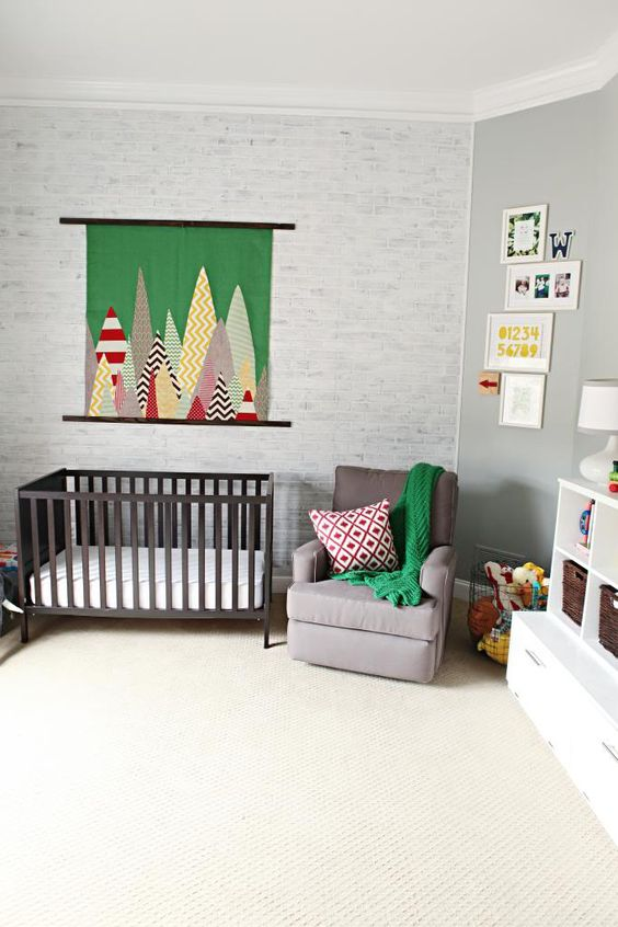 whitewashed brick wall keeps the nursery calm, peaceful and relaxing