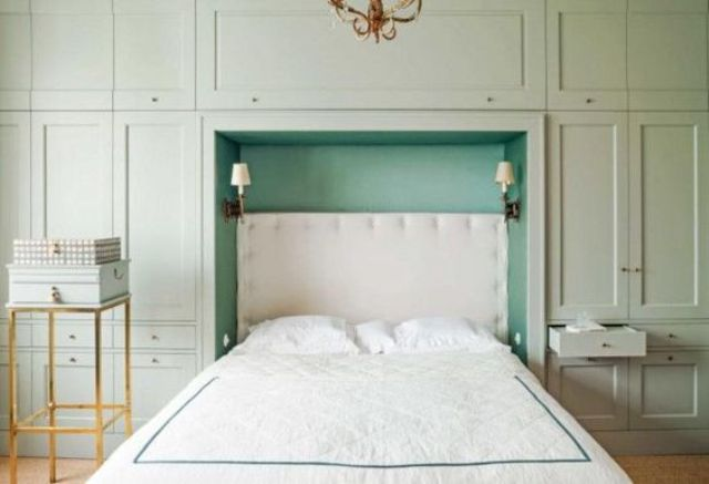 Smart bedroom storage consists of built-in wardrobes and drawers take a whole wall here, and the bed is just placed in the midst